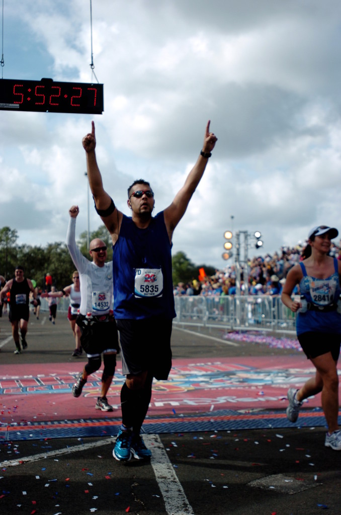 Crossing the Finish Line after running all 26.2 miles of the 2013 Walt Disney World Marathon.